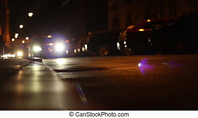 Nighttime City Streets Traffic - Cars comming one after...