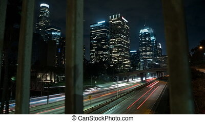 Light streaks from traffic time-lapse on the 110 freeway in downtown Los Angeles, California.