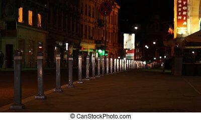 Nighttime Empty Sidewalk - Car headlights spreads over...