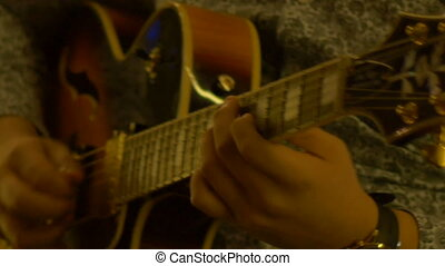 Nighttime Guitar Solo - Close-up shot of guitarist fingers...