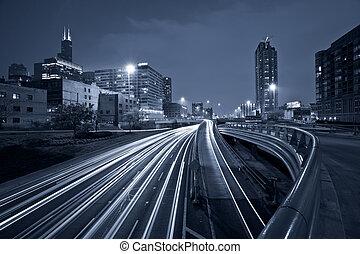 Nighttime highway traffic. - Toned image of multi lane...