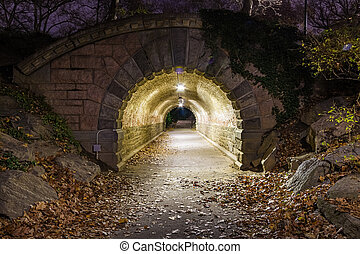 Nighttime image looking through Inscope Arch in New York City?s Central Park