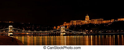 Nighttime panorama of Buda castle and Szechenyi chain bridge in Budapest, Hungary