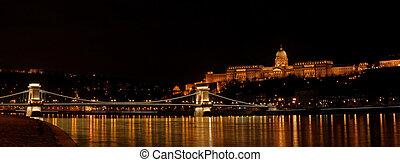 Nighttime panorama of Buda castle and Szechenyi chain bridge in Budapest, Hungary