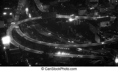 Nighttime Traffic Lights on a Highway in Bangkok in Black and White