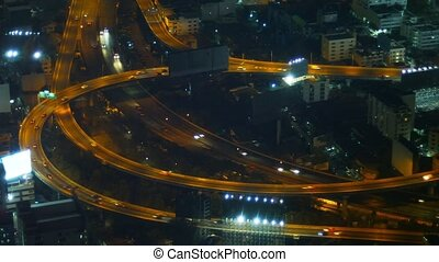 Nighttime Traffic Lights on a Highway in Bangkok