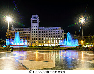 Nighttime view of Plaza de Catalunya in Barcelona, Spain