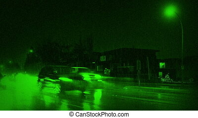 Nightvision Cars Passing Houses At Night In Heavy Rain