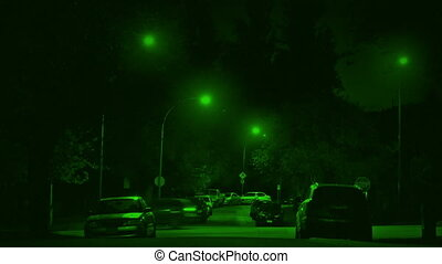 Nightvision Cars Passing Through Suburbs At Night -...