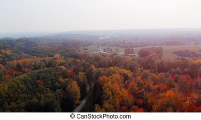 Aerial view of the Ukrainian countryside, with the famous Nikolaevsky Church appearing over the colorful, autumn treetops.