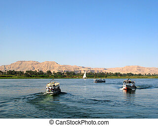 Nile river with boats in Egypt - Egyptian boats with...