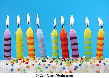 Nine birthday candles on blue background
