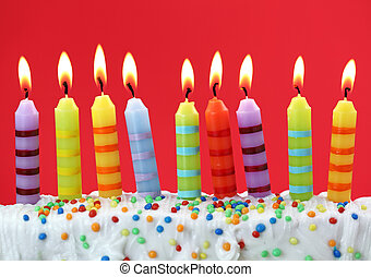 Nine birthday candles on red background