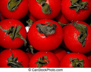 Nine bright red cherry tomatoes