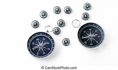 Nine small black plastic compasses and two big isolated