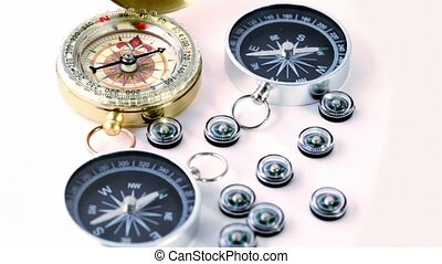 Nine small black plastic compasses, two big and one vintage...