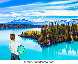 Nine-year-old boy with a globe - Exquisite Abraham Lake with...