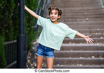 Nine-year-old girl playing with a street lamp