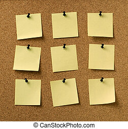 nine yellow notes pinned to cork background