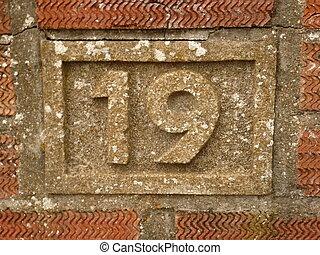 Nineteen - House number nineteen built into brick wall