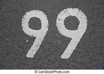 Ninety-nine sign written in white paint indicating parking...