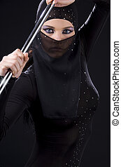 ninja - picture of ninja woman with shining pole