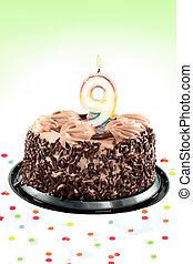 Ninth birthday - Chocolate birthday cake surrounded by...