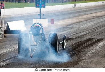Nitro drag racing - Nitro fuel race car heating up the...