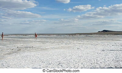People rest at the exotic salt lake