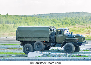 URAL-4320 curtain sided truck comes around on high obstacle