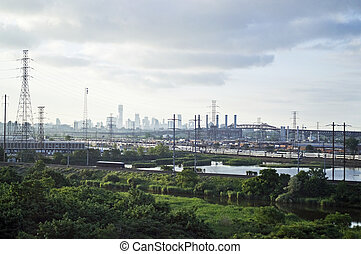 A view of the wetlands along the New Jersey Turnpike with the Pulaski Skyway and the New York City Skyline in the background.