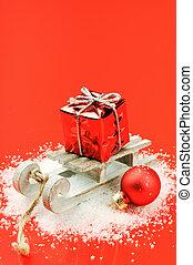 noël, traîneau, à, cadeau, sur, arrière-plan rouge