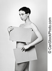 b52e6555f no clothes on. fashion style image of sexy woman covering her lady bits  with card board