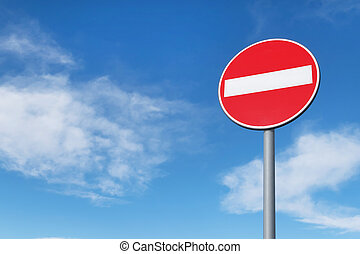 No entry round traffic sign in front of blue sky