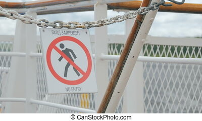 No Entry Sign on deck of cruise ship in Russia. Blows in the...