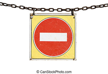 No entry traffic sign hanging from a chain