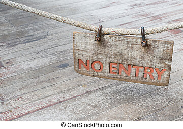 No Entry wood sign with old rope on old wood