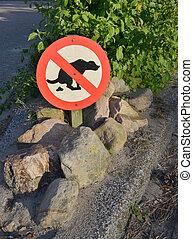 No exhaust place for dogs sign