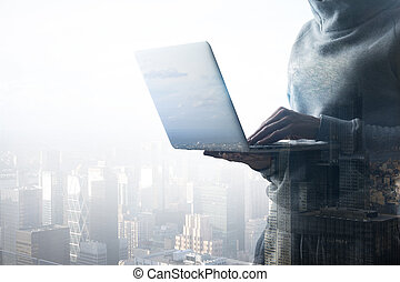 no face hacker with laptop - cyber crime concept with hacker...