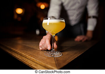 no face man holding glass with cocktail