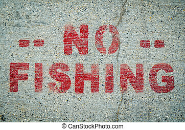 No Fishing Sign On Cement