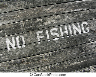 NO FISHING - No fishing sign painted on pier