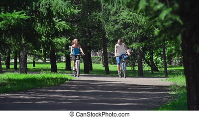 No Fuss - Two sweethearts on bicycles approaching camera...