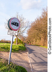 No heavy goods vehicles traffic sign and symbol against on a rur