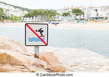 No jumping into the water allowed sign in Tamariu, Spain