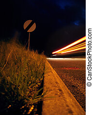 no limit - national speed limit sign at night