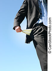 no more money - Business man holds out his pocket to show...