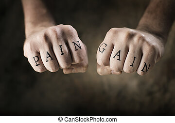"No Pain, No Gain - Man with fake tattoos ""Pain"" and ""Gain""..."