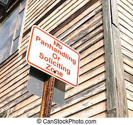 no panhandling or soliciting zone sign