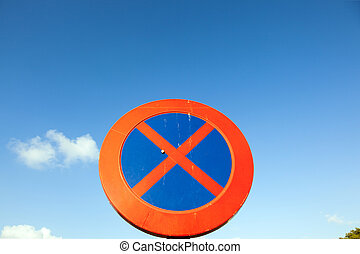 No parking and stopping sign under blue sky